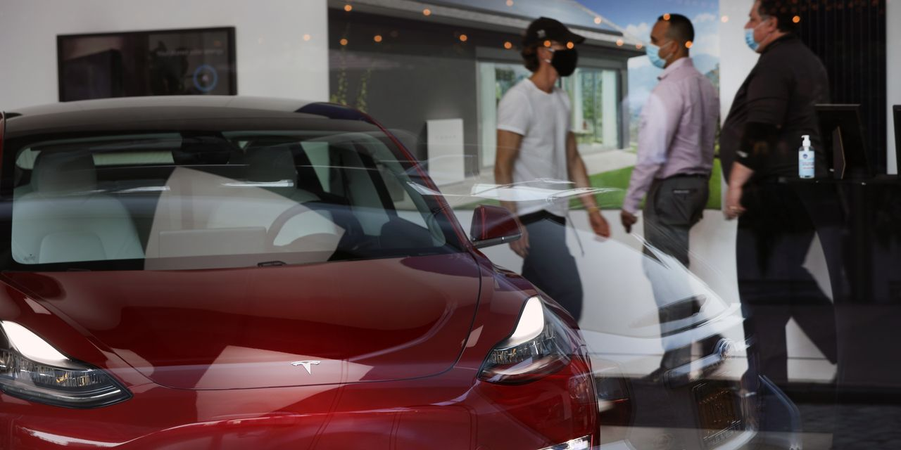 https://www.gmi-co.com/wp-content/uploads/2021/04/tesla-is-expected-to-post-record-earnings-at-start-of-turbulent-year.jpg