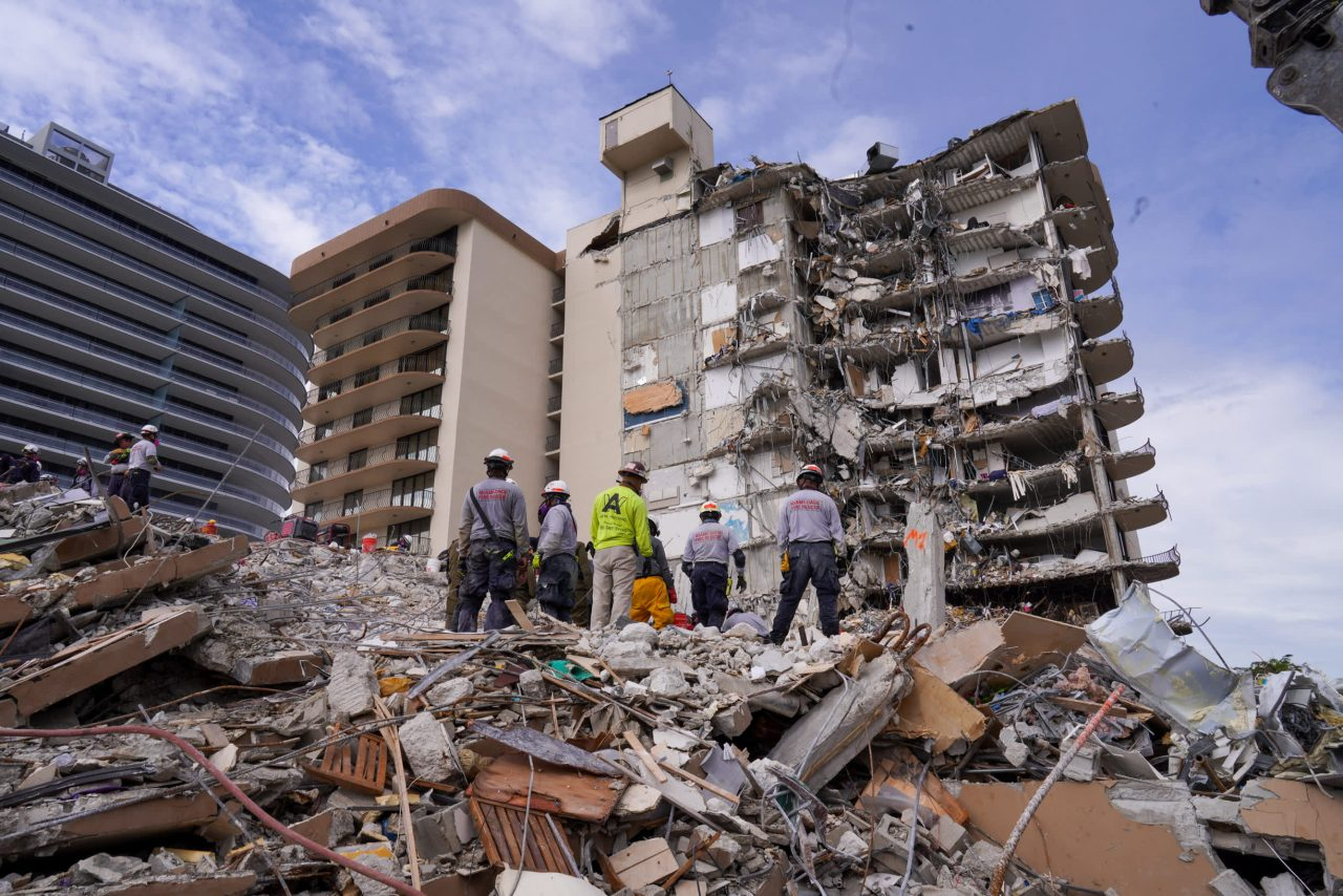 https://www.gmi-co.com/wp-content/uploads/2021/07/demolition-of-collapsed-florida-condo-tower-begins-sunday-night-search-to-resume-immediately-after-1280x854.jpg